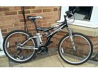 Dunlop 26in wheel mountain bike with helmet