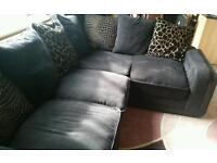 Black corner sofa with animal print