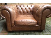 Stunning funky distressed leather chesterfield chair.