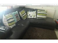 dark brown leather corner sofa, has been used daily but is ingood condition