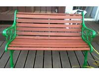Solid wood and cast iron garden bench