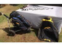 Golf club set and powakaddy.