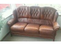 Leather three seater sofa