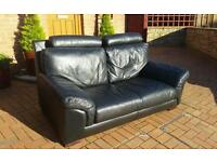 2 x 2 seaters genuine black leather sofas.