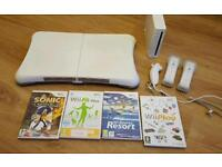 Wii, wii fit board, 2 controllers, numb chuck and 4 games