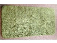 USED 65x120cm FENNELL COLOURED RUG IN GOOD CONDITION