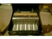 A very old lyroni an accordion