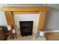 Wooden fire surround with marble base and backing