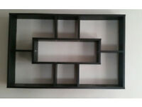 geometric black wall shelf display
