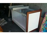 Cot with drop side