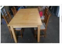 Dining table and four pine chairs