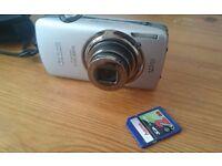 "Canon Digital IXUS 200 IS Digital Camera - Silver 12.1 Megapixel, 5x Zoom 3"" LCD"