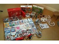 Nintendo Wii special red 25th anniversary Bundle with 24 games, and 17 Skylanders and accessories