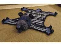 Handmade crochet rag rug in shape of bear.