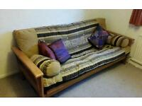 Solid wood futon double sofa bed. Excellent quality.