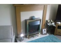 New electric fire.marble hearth.oak surround