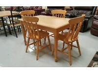 Solid dinning table with 4 chairs like new can deliver