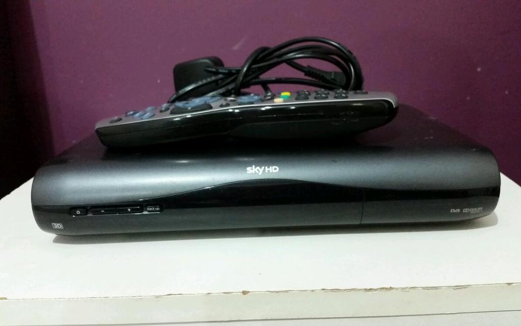 SkyHD box with remote control, power cable