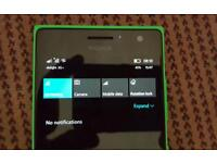 Nokia Lumia 735 green unlocked with grey wireless charging case and 32gb Samsung EVO MicroSD