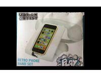 Retro phone holder and handset.