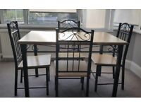 Wood laminiate dining room table with four chairs