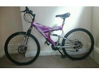 Full suspension mountain bike with disc brakes