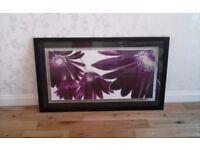 Large black framed purple flowered picture