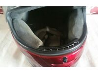 Shoei burgundy crash helmet.
