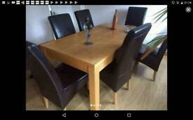 Solid oak extending table with solid real leather chairs