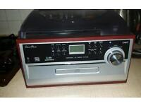 new unused Turntable with CD & MP3 Playback, AM & FM Radio and Built-in Dual Stereo Speakers