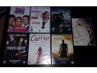 7 DVDS UNPLAYED..BRIGET JONES DIARY 1 & 2.GLADIATOR.TRUE GRIT.CARRIE.KING KONG..CELINE DION.