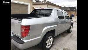 2010 Honda Ridgeline minty. Could be the one