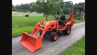 Compact tractor backhoe/loader with operator