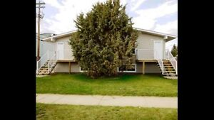2 bedroom suite in fourplex for rent Available September 1