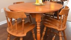 Solid wood Table , 5 chairs and matching hutch