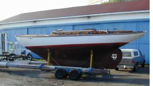 Wanted wooden sailboat restoration project .