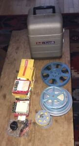 Bell and Howell Vintage 8mm Film Projector with Extras!!