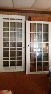 Pair of white bevelled glass doors