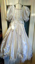 A classic full length dress with short sleeve satin bodice