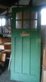 Old solid wood door, top quarter glazed