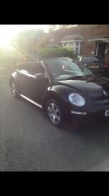 Black vw beetle convertable 1.6