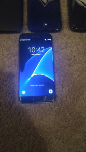 (TELUS/KOODO 32GB SAMSUNG GALAXY S7 EDGE + 3 CASES + FAST CHARGE