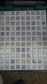 Blue and white mosaic style ceramic tiles