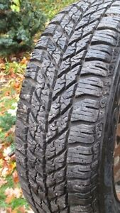 Goodyear Ultragrip snow tires on rims, Millbrook