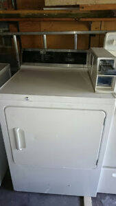 Coin operated washer/dryer and Stove