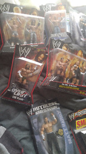 Lot of wwe action figures NEW IN BOX