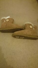 Tanned Ankle UGG boots, never worn, has authenticated certificate, size 6.5, £80