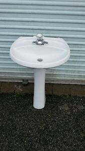 White pedestal sink with tap