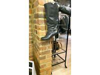 Designer black leather boots