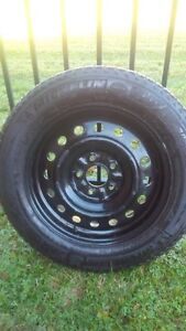 "4 x Michelin X-Ice 16"" on rims  Kitchener / Waterloo Kitchener Area image 1"